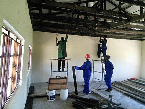 Carpentry students learn how to put up a ceiling in the new classrooms