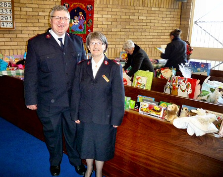 Mrs Grace Arnott and helpers from The Salvation Army collect donated toys for local distribution